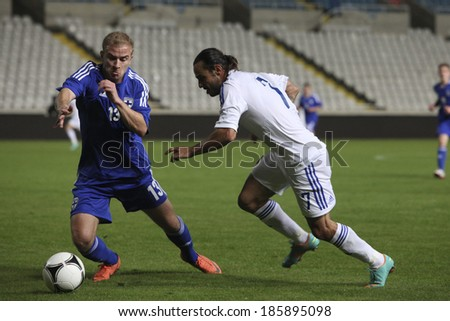CYPRUS,NICOSIA - NOV 14:Kari Arkivuo and Efstathios ALONEFTIS during the game between Cyprus and  Finland for an international friendly match at Gsp Stadium in Nicosia on November 14th,2012 - stock photo