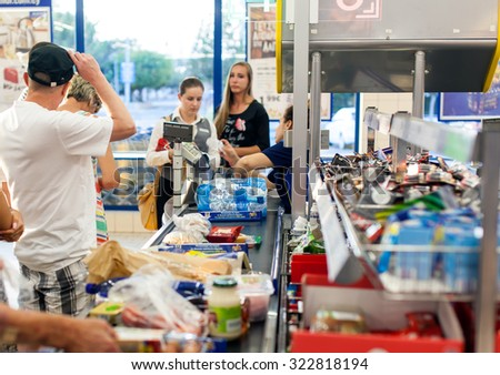 CYPRUS, PROTARAS, SUPERMARKET LIDL - 19.09.2015:Customers paying for shopping at a supermarket. Line at the cashdesks in the supermarket - stock photo