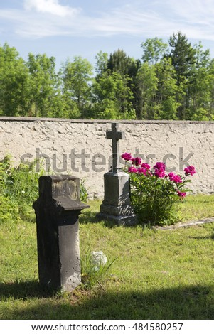 CZECH CEMETERY - JUNE 14, 2015: Traditional cemeteries in the Bohemia are treasury of religion arts, beautiful historic tombstones with statues of saints decorate graves.