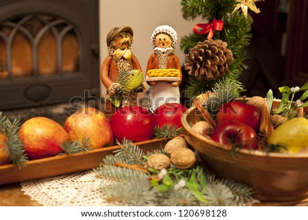 Czech christmas decoration with figures, apples and twigs - stock photo