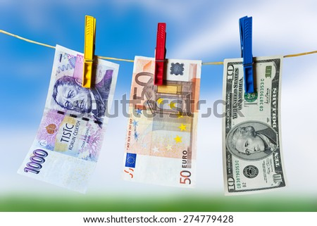Czech crown banknote - finance and economy - money hanging on the rope - stock photo