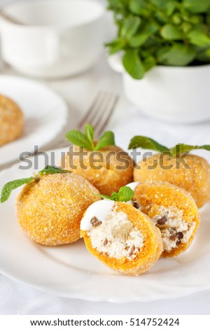 Czech cuisine dish - pumpkin dumpling filled with cottage cheese