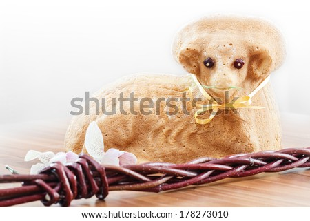 Czech Easter - baked lamb with powdered sugar and special handmade whip on wood desk - stock photo