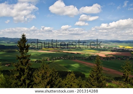 Czech landscape with mountains, clouds and trees - stock photo