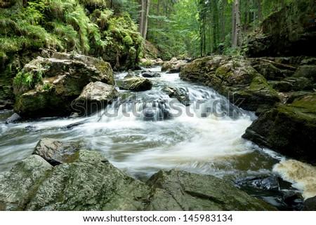 czech mountain creek Doubrava in Czech Republic with slow shutter speed - stock photo