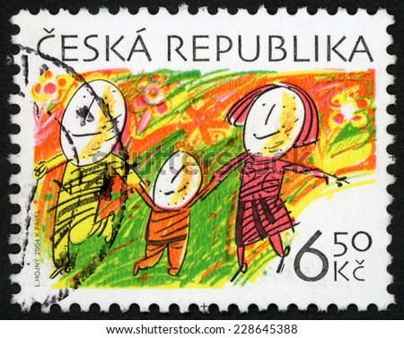 CZECH REPUBLIC - CIRCA 2004: easter stamp printed in Czechoslovakia (Ceska) shows egg family holding hands, walking through blooming spring nature blazing with color; Scott 3232 A1245 6.5k, circa 2004 - stock photo
