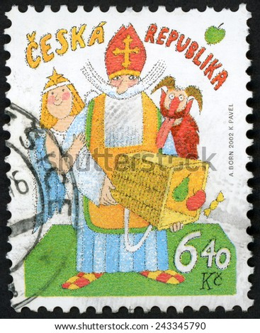 CZECH REPUBLIC - CIRCA 2002: post stamp printed in Czechoslovakia (Ceska) shows angel, devil, st. Nicholas holding basket with fruit; Saint Nicholas day; Scott 3181 A1217 6.40k multicolor, circa 2002 - stock photo