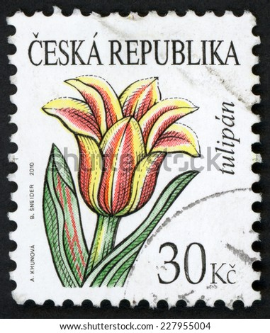 CZECH REPUBLIC - CIRCA 2010: post stamp printed in Czechoslovakia (Ceska) shows illustration of tulip (tulipan) flower on white background; beauty of flowers series; 30k red green yellow, circa 2010 - stock photo