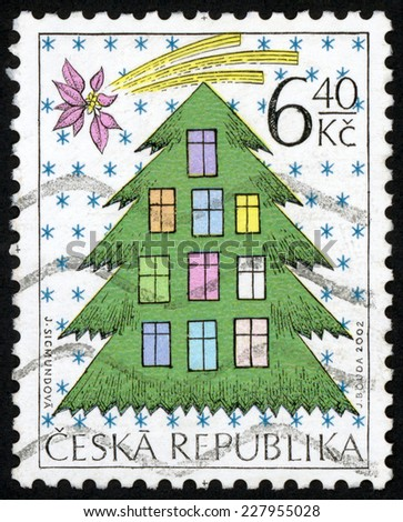 CZECH REPUBLIC - CIRCA 2002: post stamp printed in Czechoslovakia (Ceska) shows illustration of Christmas tree with ten windows and christmas flower star; Scott 3182 A1218 6.40k multicolor, circa 2002 - stock photo