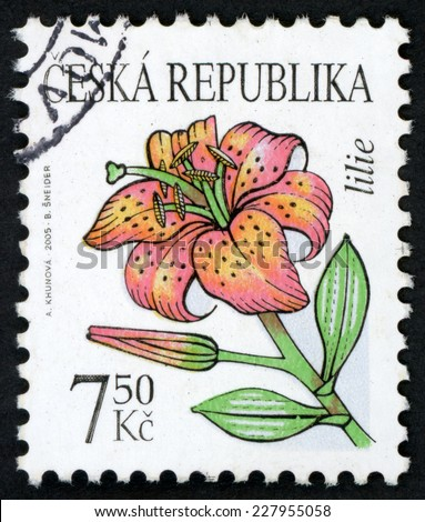 CZECH REPUBLIC - CIRCA 2005: post stamp printed in Czechoslovakia (Ceska) shows illustration of lily (lilie) on white background; beauty of flowers, Scott 3262 A1215 7.50k pink green, circa 2005 - stock photo