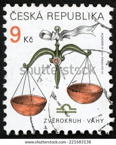 CZECH REPUBLIC - CIRCA 2001: post stamp printed in Czechoslovakia (Ceska) shows zverokruh vahy; horoscope sign libra; astrological zodiac symbol; Scott 3065 A1149 9k brown green, circa 2001 - stock photo