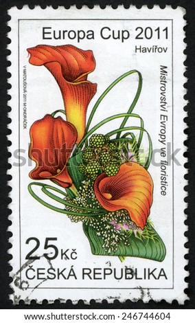 CZECH REPUBLIC - CIRCA 2011: stamp printed in Ceska (Czechoslovakia) shows arrangement with Zantedeschia flowers (lily); Europa cup florist championship Havirov; Scott 3506 25k red green, circa 2011 - stock photo