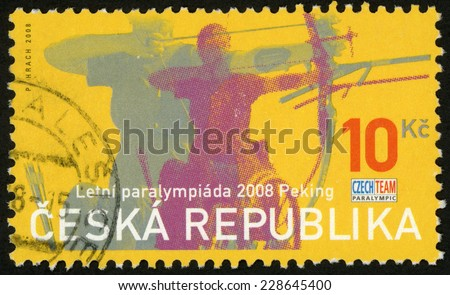 CZECH REPUBLIC - CIRCA 2008: stamp printed in Ceska shows handicapped sportsmen on wheelchair, competition in archery; 8th summer Paralympic games; Beijing (Peking); Scott 3390 10k yellow, circa 2008 - stock photo