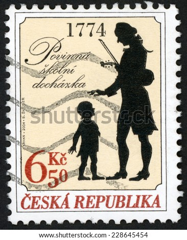 CZECH REPUBLIC - CIRCA 2004: stamp printed in Czechoslovakia (Ceska) shows teacher with violin & child; compulsory school attendance in 1774, 230th anniversary; Scott 3251 6.5k black red, circa 2004 - stock photo