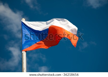 Czech Republic flag against blue sky - stock photo