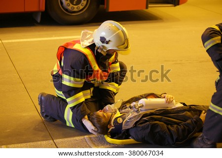 CZECH REPUBLIC, PLZEN,  30 SEPTEMBER,  2015:Brave firefighter relieve an injured after car accident - stock photo