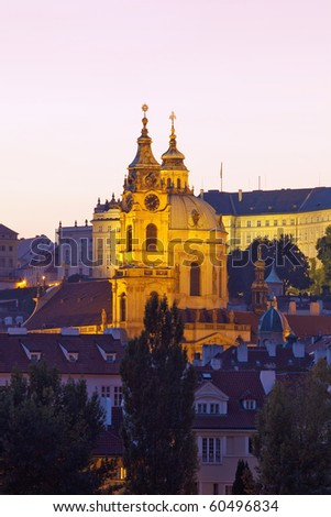 czech republic, prague - illuminated st. nicolaus church at dusk
