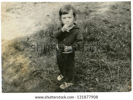 CZECHOSLOVAK REPUBLIC, CIRCA 1975 - Child with finger in mouth - circa 1975 - stock photo