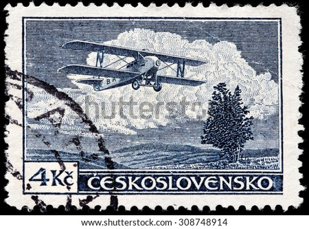 CZECHOSLOVAKIA - AUGUST 10, 2015: A stamp printed by CZECHOSLOVAKIA shows Letov S-19 Smolik - an airplane produced in Czechoslovakia during the 1920s, circa December, 1930. - stock photo