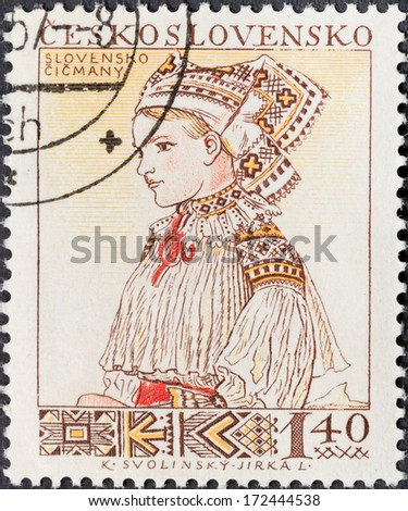 CZECHOSLOVAKIA- CIRCA 1956: A postage stamp printed in the Czechoslovakia shows portrait of young woman in Slovenian (Cicmany) national costume, circa 1956 - stock photo