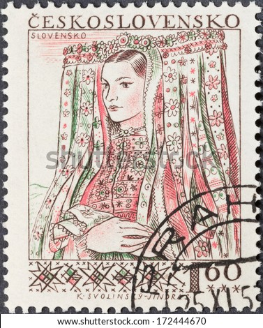 CZECHOSLOVAKIA- CIRCA 1956: A postage stamp printed in the Czechoslovakia shows portrait of young woman in Slovenian national costume, circa 1956 - stock photo
