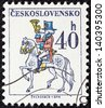 "CZECHOSLOVAKIA - CIRCA 1974: A stamp printed in Czechoslovakia from the ""Czechoslovak Postal Services"" issue shows Postilion, circa 1974. - stock photo"