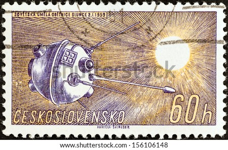 "CZECHOSLOVAKIA - CIRCA 1961: A stamp printed in Czechoslovakia from the ""Space Research (1st series)"" issue shows Luna 1, circa 1961.  - stock photo"