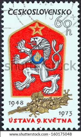 CZECHOSLOVAKIA - CIRCA 1973: A stamp printed in Czechoslovakia issued for the 25th anniversary of May 9th Constitution shows Czechoslovak Arms, circa 1973.  - stock photo