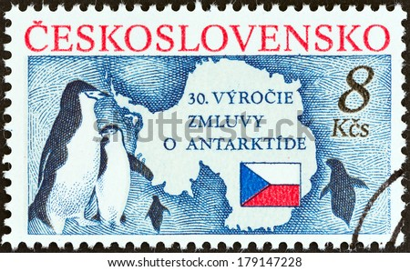 CZECHOSLOVAKIA - CIRCA 1991: A stamp printed in Czechoslovakia issued for the 30th Anniversary of Antarctic Treaty shows Bearded Penguins, Map and Flag, circa 1991. - stock photo