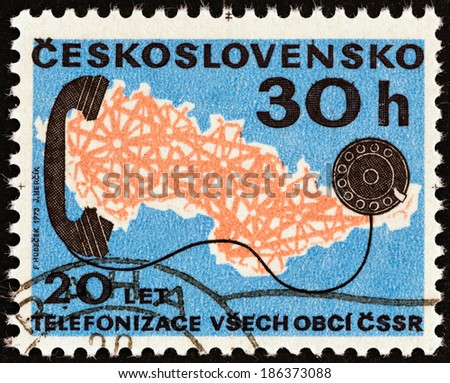 CZECHOSLOVAKIA - CIRCA 1973: A stamp printed in Czechoslovakia issued for the 20th anniversary of nationwide telephone system shows Map and telephone, circa 1973.  - stock photo