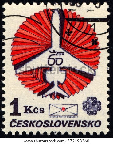 CZECHOSLOVAKIA - CIRCA 1983: A stamp printed in Czechoslovakia issued for the World Communications Year and 60th anniversary of Czechoslovak Airlines shows Ilyushin Il-62 and envelope, circa 1983.  - stock photo