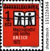 CZECHOSLOVAKIA - CIRCA 1972: A stamp printed in Czechoslovakia showing an open book with silhouette of two man to commemorate UNESCO International Year Book, circa 1972 - stock photo
