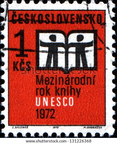 CZECHOSLOVAKIA - CIRCA 1972: A stamp printed in Czechoslovakia showing an open book with silhouette of two man to commemorate UNESCO International Year Book, circa 1972