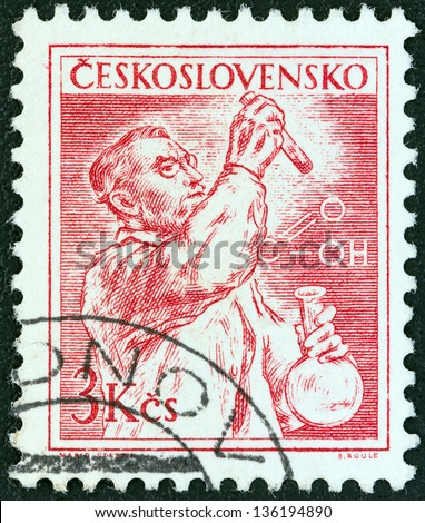 CZECHOSLOVAKIA - CIRCA 1954: A stamp printed in Czechoslovakia shows a chemist, circa 1954. - stock photo