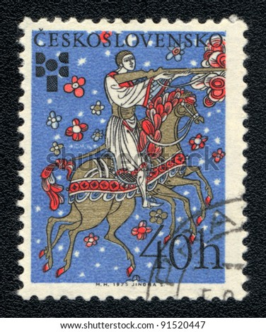 CZECHOSLOVAKIA - CIRCA 1975: A stamp printed in CZECHOSLOVAKIA  shows a folklore hunter with a gun on a horse multilegged, series, circa 1975 - stock photo