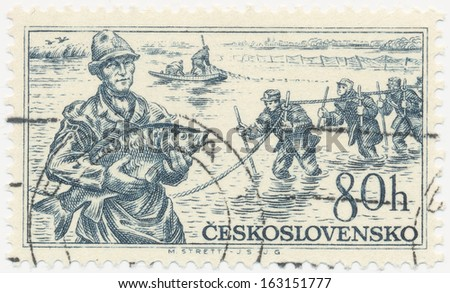 CZECHOSLOVAKIA - CIRCA  1956: A stamp printed in Czechoslovakia shows fisherman with carp in hands, circa 1956