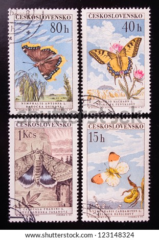 CZECHOSLOVAKIA - CIRCA 1975: A stamp printed in Czechoslovakia shows four kinds of colorful flying butterflies , circa 1975. - stock photo