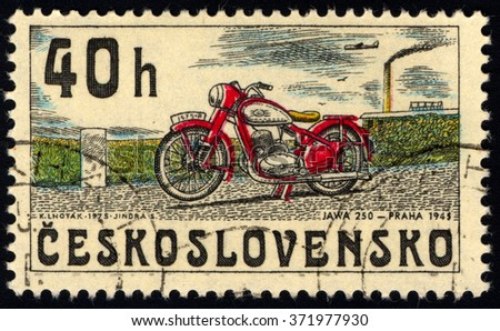 CZECHOSLOVAKIA - CIRCA 1975: A stamp printed in Czechoslovakia shows image of a vintage motorcycle, JAWA 250 year 1945, circa 1975 - stock photo
