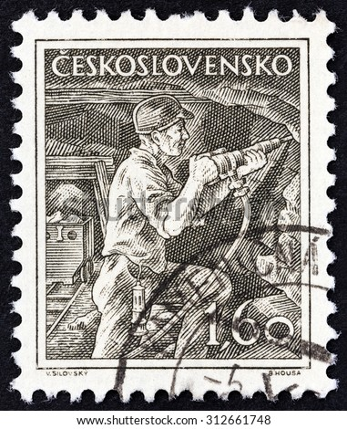 CZECHOSLOVAKIA - CIRCA 1954: A stamp printed in Czechoslovakia shows miner, circa 1954. - stock photo