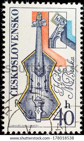 CZECHOSLOVAKIA - CIRCA 1974: A stamp printed in Czechoslovakia, shows Musical instrument, circa 1974  - stock photo