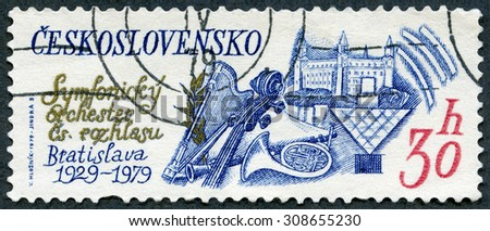 CZECHOSLOVAKIA - CIRCA 1979: A stamp printed in Czechoslovakia shows Musical Instruments,Bratislava Castle, Fine Arts Academy, Bratislava 30th anniversary Slovak Technical University, circa 1979 - stock photo