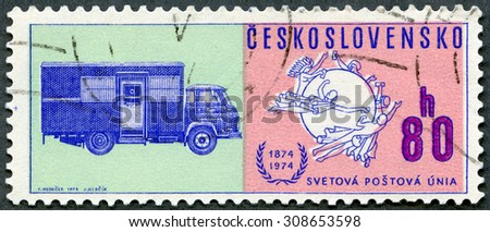 CZECHOSLOVAKIA - CIRCA 1974: A stamp printed in Czechoslovakia shows UPU Universal Postal Union Emblem and Early mail truck, circa 1974 - stock photo