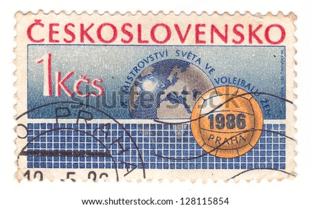 CZECHOSLOVAKIA - CIRCA 1986: A stamp printed in Czechoslovakia, shows Volleyball, net, globe, circa 1986 - stock photo