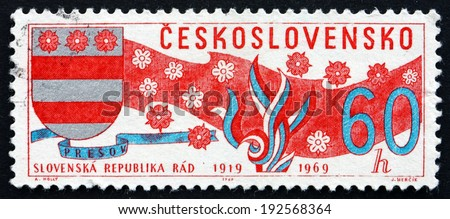 CZECHOSLOVAKIA - CIRCA 1969: a stamp printed in the Czechoslovakia shows Arms of Slovakia, Banner and Blossoms, circa 1969 - stock photo