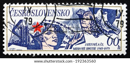 CZECHOSLOVAKIA - CIRCA 1979: a stamp printed in the Czechoslovakia shows Red Star, Man, Child and Doves, Peace Movement, 30th Anniversary, circa 1979 - stock photo