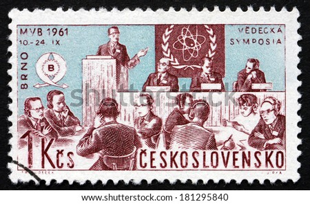 CZECHOSLOVAKIA - CIRCA 1961: a stamp printed in the Czechoslovakia shows Scientists'?? Meeting and Nuclear Physics Emblem, International Trade Fair, Brno, circa 1961 - stock photo