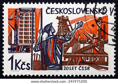 CZECHOSLOVAKIA - CIRCA 1965: a stamp printed in the Czechoslovakia shows Worker and new Constructions, 20th Anniversary of Liberation from the Nazis, circa 1965 - stock photo