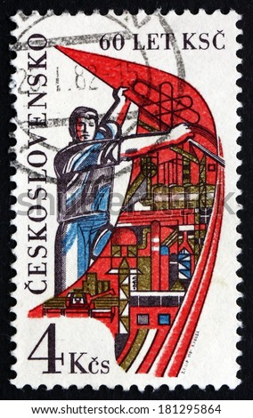 CZECHOSLOVAKIA - CIRCA 1981: a stamp printed in the Czechoslovakia shows Worker Holding Banner, 60th Anniversary of the Czechoslovakian Communist Party, circa 1981 - stock photo
