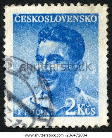 CZECHOSLOVAKIA - CIRCA 1949: post stamp printed in Ceskoslovensko shows Czech journalist Julius Fucik (1903-1943); notes from gallows; executed by Nazis; Scott 377 A141 2k blue; circa 1949 - stock photo