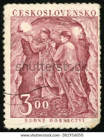 CZECHOSLOVAKIA - CIRCA 1951: post stamp printed in Ceskoslovensko shows two men; mining iron ore; Miners day; Rudne hornictvi; Scott 480 A187 3k red brown, circa 1951 - stock photo